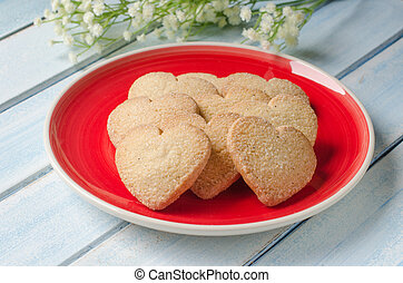 Heart-shaped butter cookies with sugar - Purple plate with...