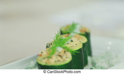 Delicious stuffed zucchini rotating