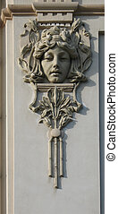 Bas-relief in the form of a woman\'s face