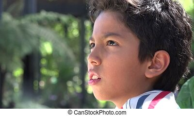 Boy Looking Into Distance