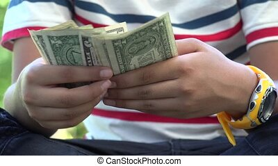 Hispanic Boy Handling Paper Money