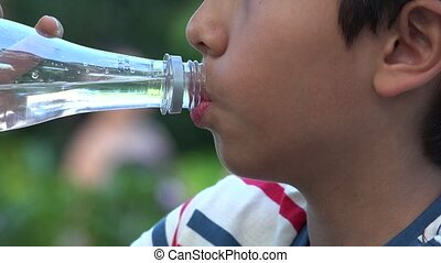 Boy Drinking Bottled Water