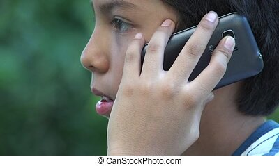 Hispanic Boy Using Cell Phone