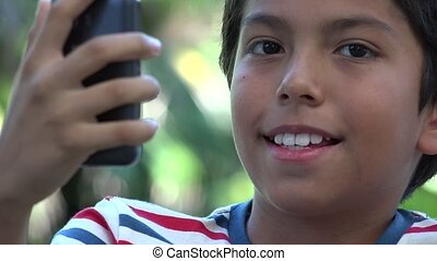 Hispanic Boy Taking Selfie