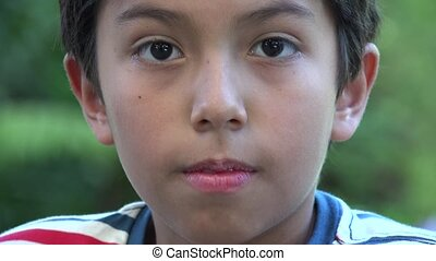 Surprised Young Hispanic Boy