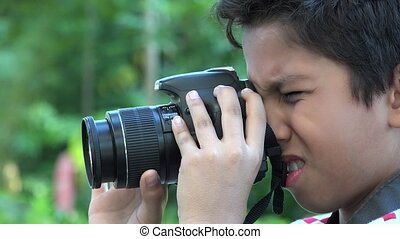 Boy Using DSLR Camera