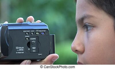 Boy Using Video Camcorder