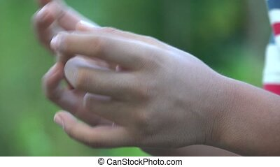 Boy Twiddling His Fingers