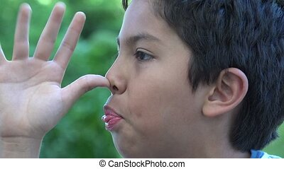 Young Boy Making Funny Faces