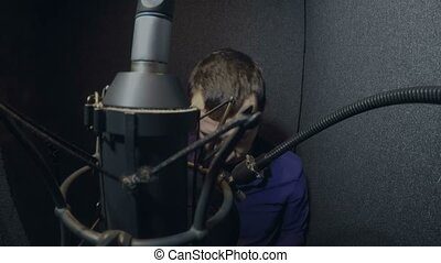 man singer in headphones singing a song in the studio - man...