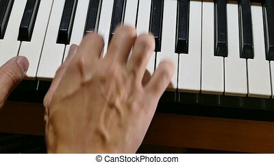 playing synthesizer man piano hand run over keys - playing...