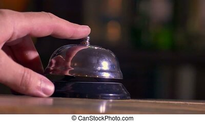 man pushes call bell at the hotel - man pushes call bell at...
