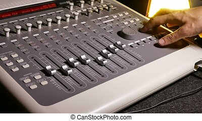 man brings music mixer music studio remote - man brings...
