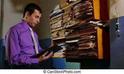Accounting clerk said the paper work in the office of an old...