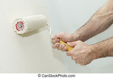 Painter worker hand with roller - Painter worker hand at...