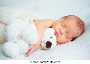 Cute newborn baby sleeps with toy teddy bear - Cute newborn...