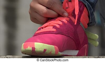 Young Girl Tying Her Sneakers