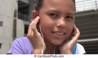 Child Listing to Music on Headphones