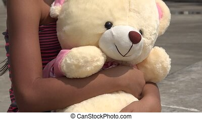 Teddy Bear and Young Child