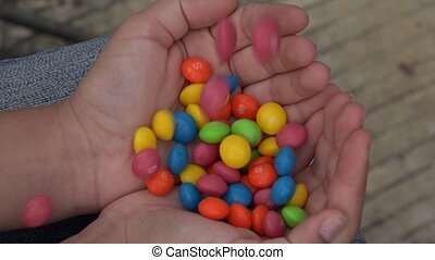 Colorful Candy in Girls Hands