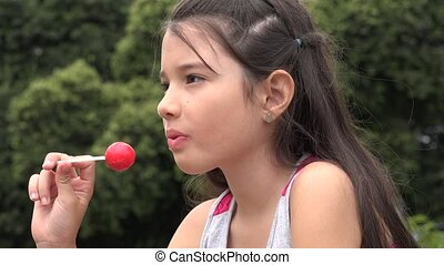 Young Girl Eating Lollipop