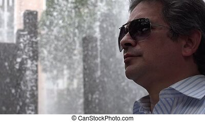 Man Wearing Sunglasses at Fountain