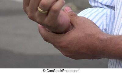 Man Experiencing Pain in Hand