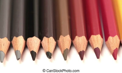Color pencils in a row .