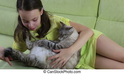 Little girl communicates with her beloved cat.
