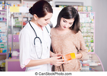 Doctor woman in uniform showing product to customer