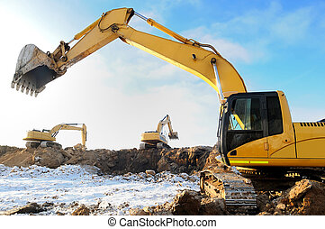 loader excavator bulldozers at work - group of excavators...