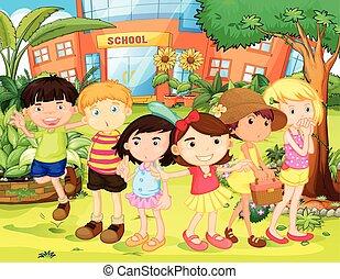 Boys and girls having fun in the school yard