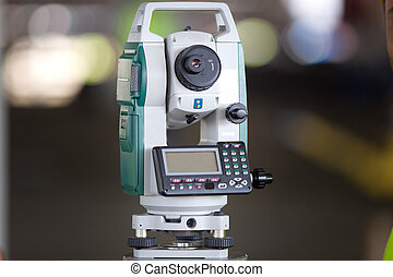 Theodolite at construction site - Close up of surveying...