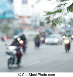 car and motorcycle driving on road