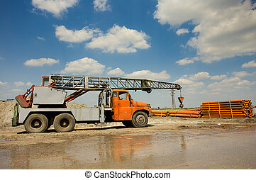 Truck with crane working at construction site - Mobile crane...