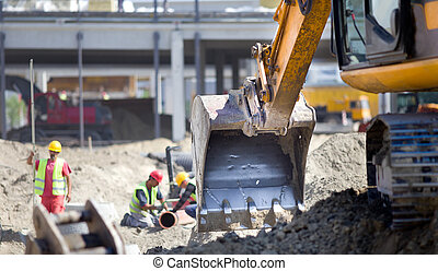 Construction site atmosphere - Close up of excavator bucket...
