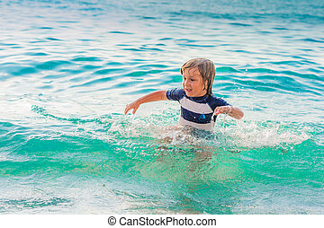 Adorable kid having fun on summer vacation, playing in the...