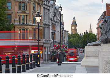 Big Ben with red London bus seen from Trafalgar square,...