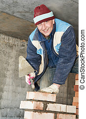 construction mason worker bricklayer - hands of a...