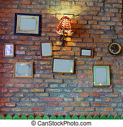Nostalgia wall with empty frames for photographs.