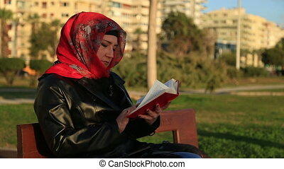 Muslim woman reading book - Beautiful muslim woman wearing...