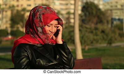 Muslim woman talking on the phone - Arabic muslim woman...
