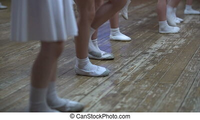 Ballet. View of little girls learn dance moves, close-up