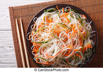 Glass noodle salad with cucumber and carrot close-up....