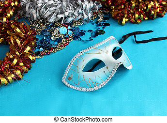 Blue carnival mask on a blue background with festive...