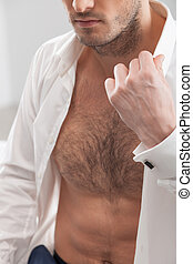 Handsome young guy is expressing his sexuality - Close up of...