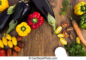 Composition with vegetables on a wooden background
