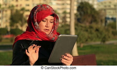 Muslim woman using digital tablet