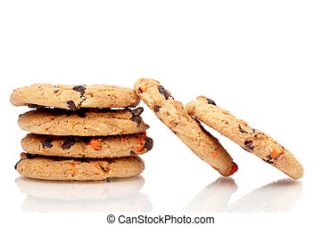 A vertical stack of chocolate chip cookies with 2 resting on...