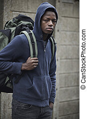 Teenage Boy On The Streets With Rucksack